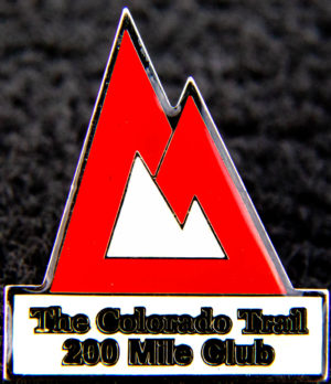 """red pine labeled """"The Colorado Trail 200 Mile Club"""""""