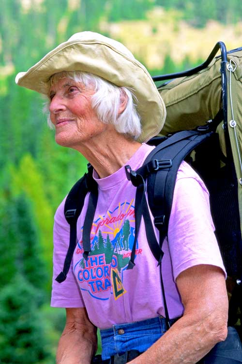 Gudy Gaskill wearing a backpack and Colorado Trail T-shirt