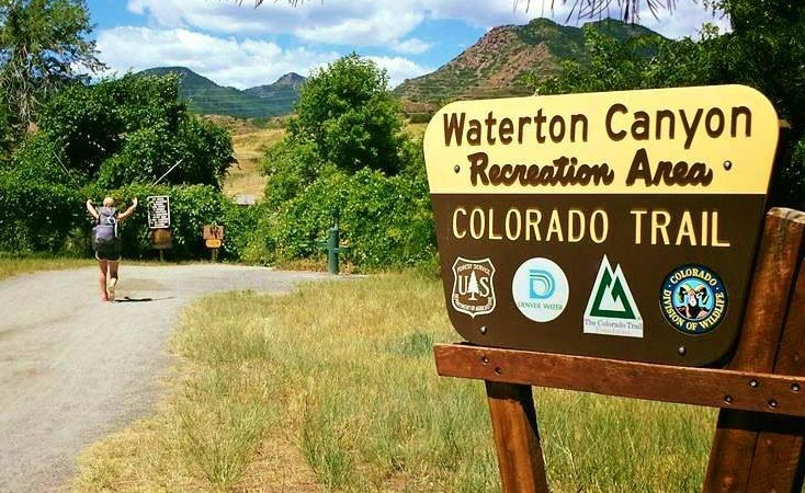 hiker ant Waterton Canyon trail sign