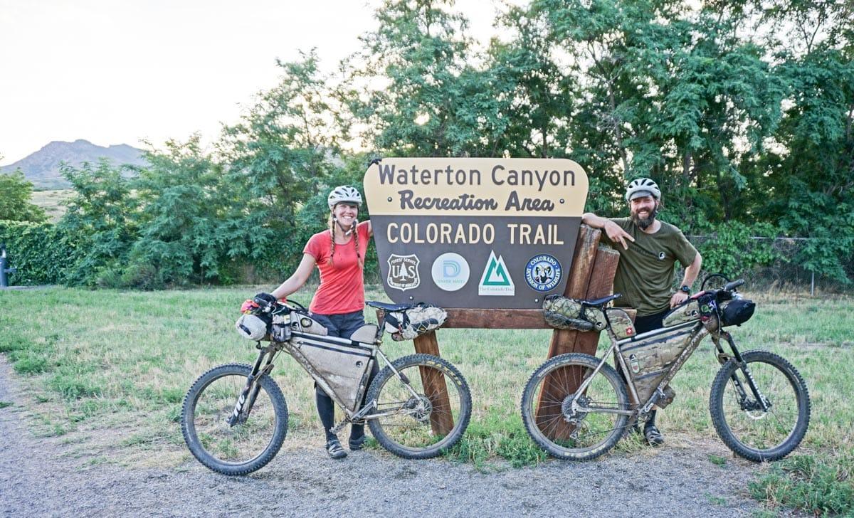 Cyclists at Waterton Canyon sign