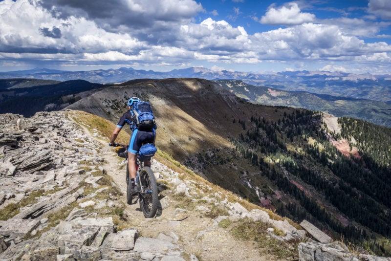 bicyclist on high ridge
