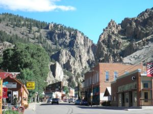 main street of Creede and steep rocks above town