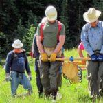 team carrying log