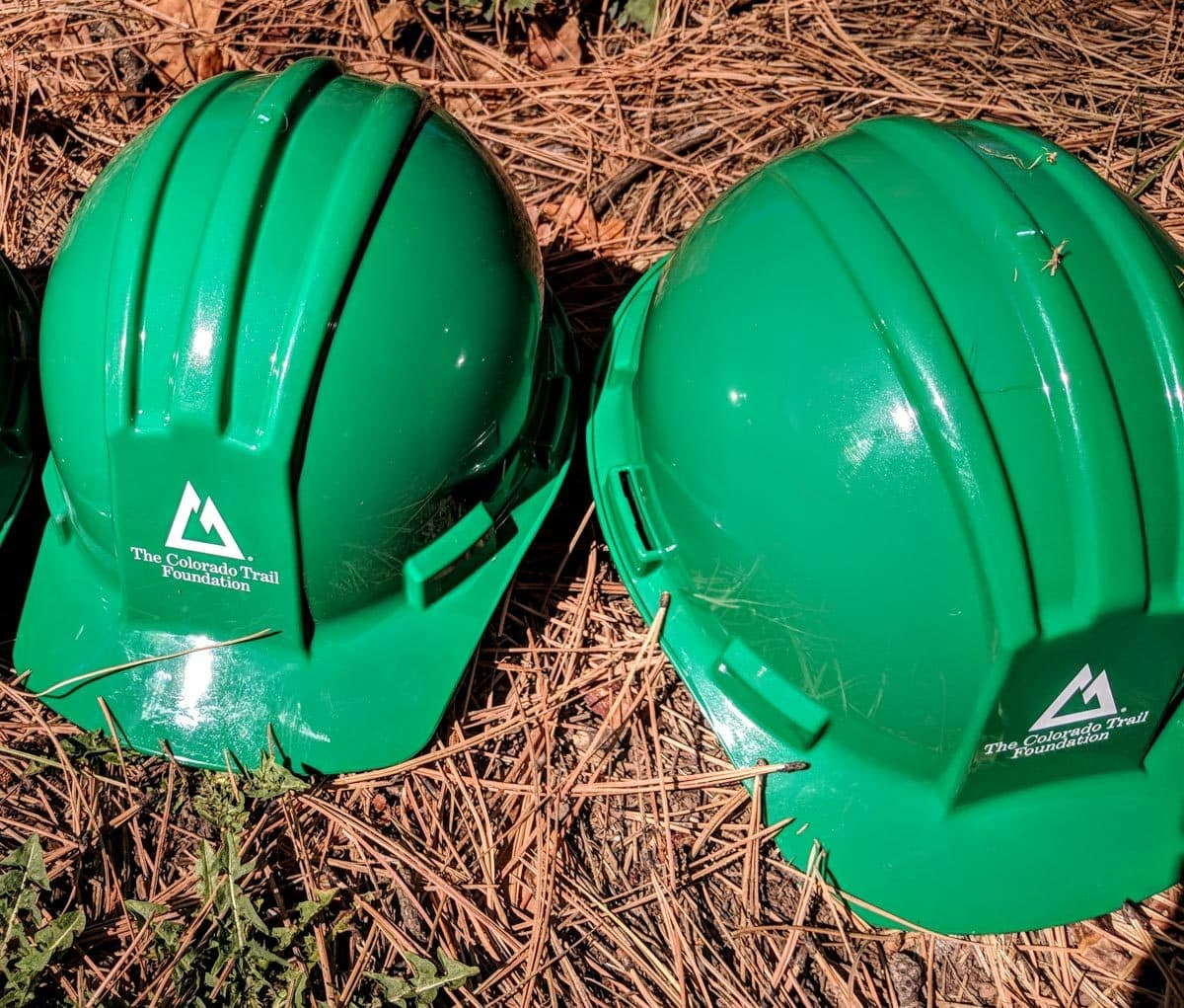 two green hard-hats with CTF logo