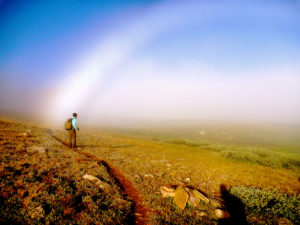 Hiker and beautiful arc of light