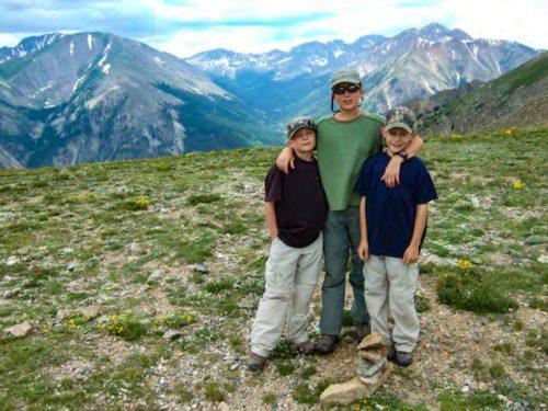 Eli, Roy, and Jonas VanZweden and mountains