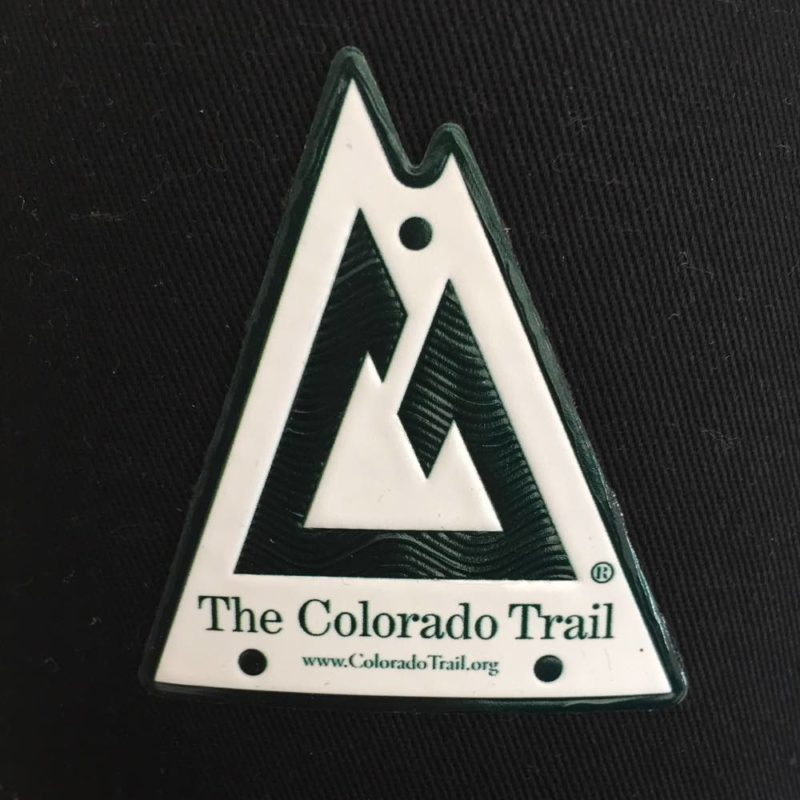 Colorado Trail marker looks great on this black cap.