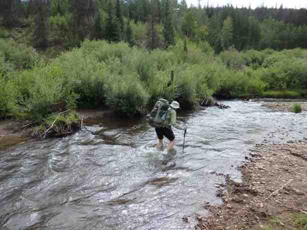 Kerrie Neet easily crossing Cochetopa Creek in July. Photo by Ray Kenny.