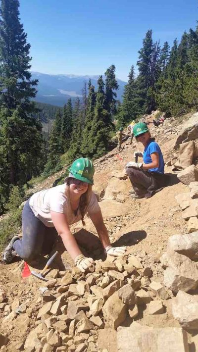 Paige Delmargo and Karen Sauerhagen help build a new CT reroute on the Collegiate West.