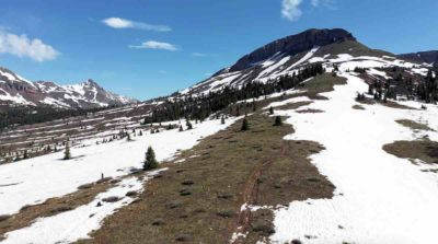 Increasingly passable, this year's record-deep snowpack is melting. This photo thanks to Peter Bassinger is of CT Segment 25 near Molas Pass above Silverton.